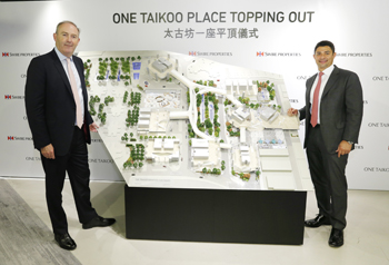 Swire Properties' Chief Executive, Guy Bradley (left) and Director, Office, Don Taylor, unveiled details of One Taikoo Place at the topping-out ceremony.
