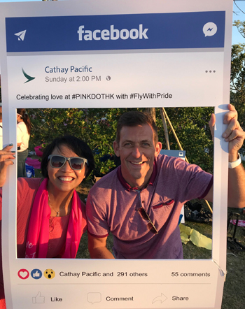 Olivia Wong, Head of Diversity & Inclusion Development of John Swire & Sons (HK) Ltd., and Josh Rogers, Cathay Pacific's Head of Airport Customer Service, enjoy themselves at the Pink Dot Festival picnic hosted by FlyWithPride.
