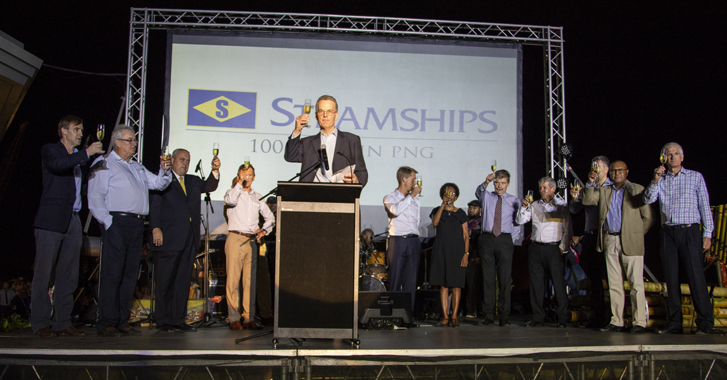 Barnaby Swire offers a toast to the Independent State of Papua New Guinea. He was joined by Steamships directors, including the company's Chairman, Geoff Cundle, (fifth from right), and PNG's Minister for Lands & Physical Planning and APEC 2018, Mr Justin Tkatchenko, (second from right).