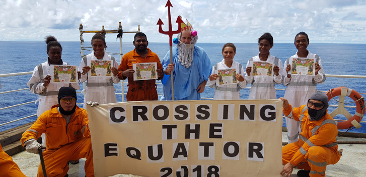 Amy-Lee Turia, Lylellah Kunai, Glenda Amu, Jamie-Lee Baim, and Irma Rua proudly display their certificates after crossing the Equator for the first time. 'King Neptune' is Chief Engineer Andi Magas.
