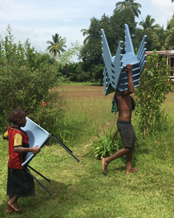 New classroom furniture delivered to a remote village in the Sepik River region.
