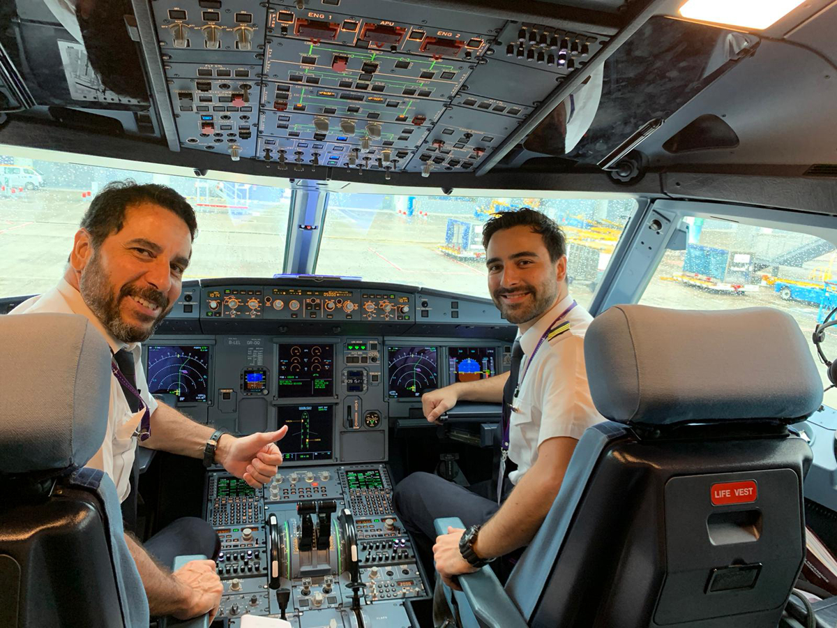 Captain Wilson (left) and his son Rodrigo working together on the same flight-deck.