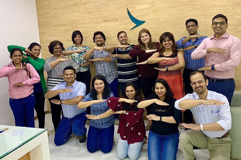 "Staff at Cathay Pacific's Mumbai Town Office striking the ""hands out"" equal pose – a reflection of the International Women's Day 2020 campaign theme of #eachforEqual."
