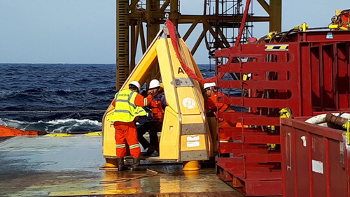 Preparing to transfer the three fishermen to Pacific Valour using the platform crane.